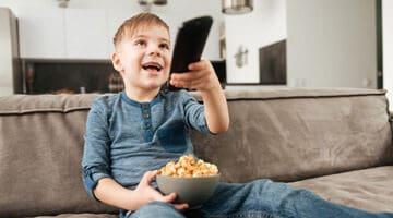 cute boy holding remote control